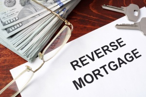Reverse mortgage form on a table and money.