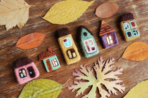 toy houses and autumn leaves